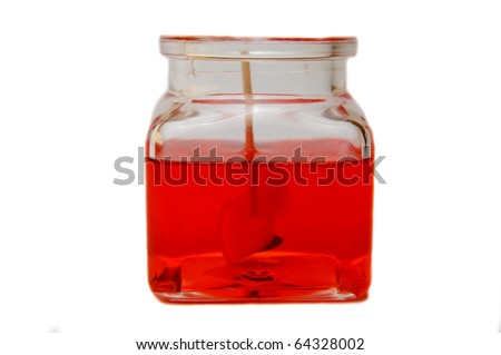 Red candle with heart in jar isolated on white background