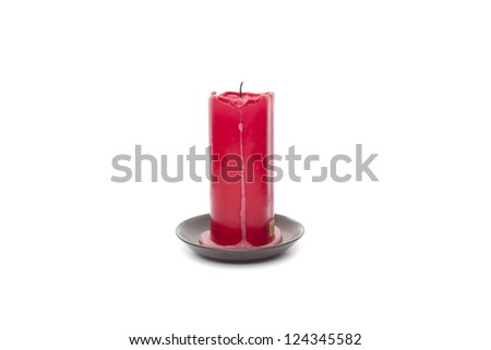 Red candle with wax isolated on white background - stock photo
