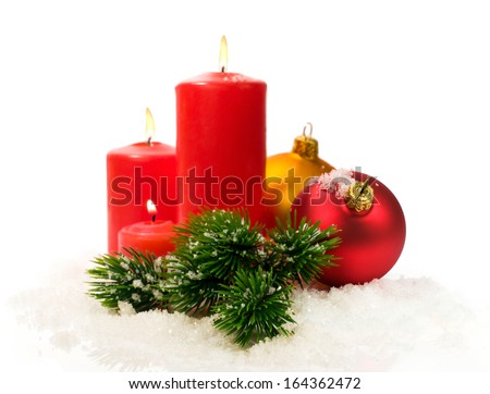 red candles and fir branches and Christmas balls in snow isolated on white - stock photo