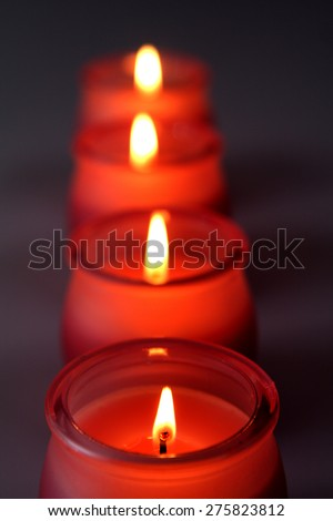 Red candles in a line - stock photo