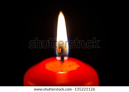 Red candles with black background