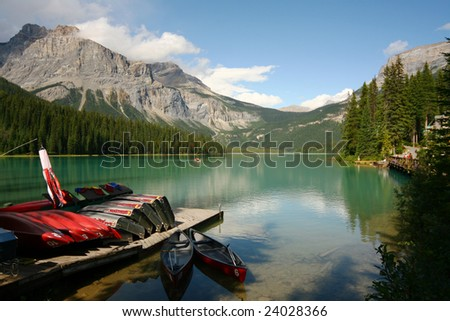 Red Canoes and Boats at Dock on Mountain Lake (H)