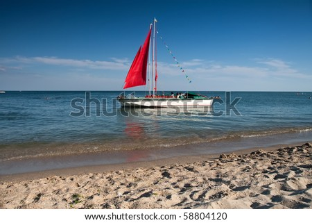 red canvas boat on the sea