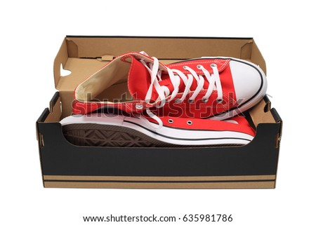 Red canvas sneakers, isolated over white with clipping path