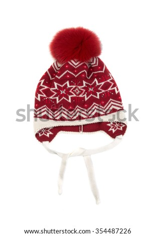 Red cap with a pattern and a pom-pom. Isolate on white. - stock photo