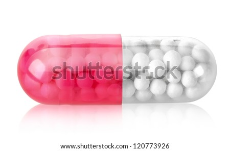 Red capsule isolated on a white background - stock photo