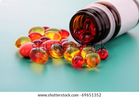 red capsules of vitamins on a blue background - stock photo