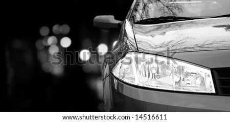 Red car in traffic at night - stock photo