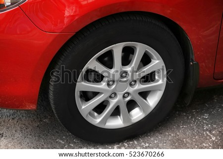 Red car wheel, close up