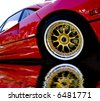 Red Car With Gold Wheels - stock photo