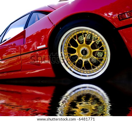 Red Car With Gold Wheels