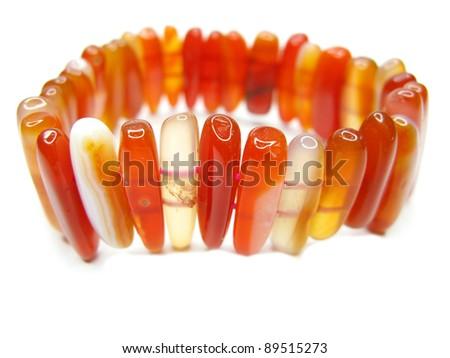 red carnelian semigem bracelet jewelry isolated on white background - stock photo