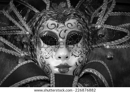 red carnival mask, black and white image - stock photo
