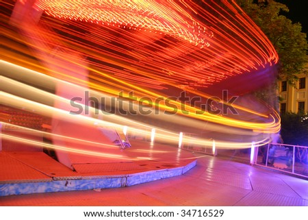 Red carousel on the move - stock photo