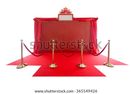red carpet and rope barrier and backdrop on white. - stock photo