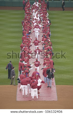 Red carpet being rolled out for player introductions of the 2008 Opening Game of the Philadelphia Phillies on March 31, 2008, Citizen Bank Park - stock photo