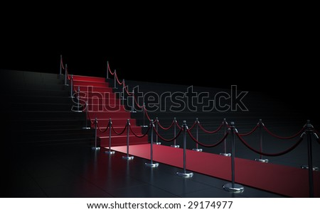 Red carpet leading up to stairs - stock photo