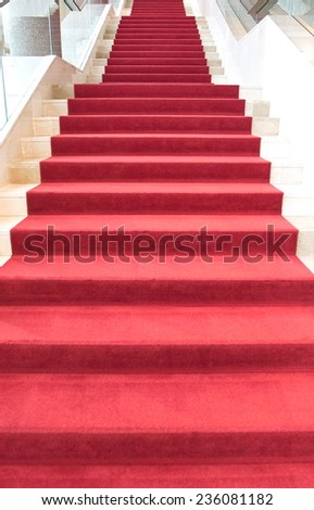 Red carpet on stairs - stock photo