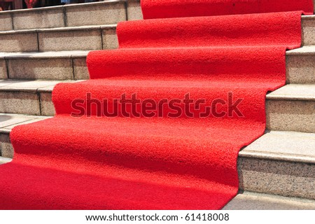 Red Carpet On The Steps Leading To The Doorway - stock photo