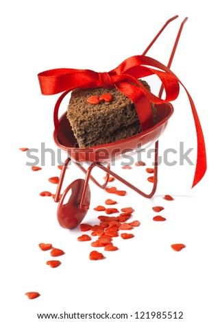 Red Cart St. Valentine's Day with Biscuit Cookies tied up by the Red Ribbon and Little Hearts Isolated on White - stock photo