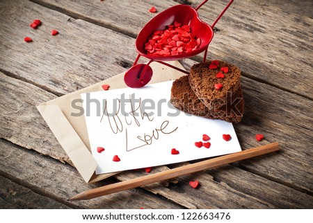 Red Cart with St. Valentine's Day Little Hearts and  Letter Isolated on White Your Own Text - stock photo