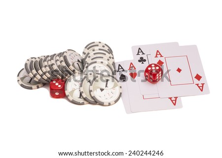 Red casino dice, four aces playing cards and casino chips - stock photo