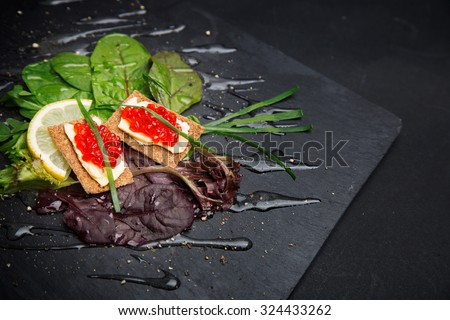 Red caviar canapes in gourmet restaurant - stock photo
