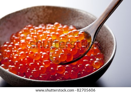 Red caviar in the spoon. - stock photo