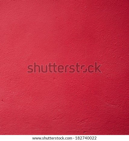 Red cement wall texture background, close up.