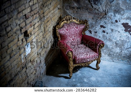 Red chair and old walls. brick texture - stock photo