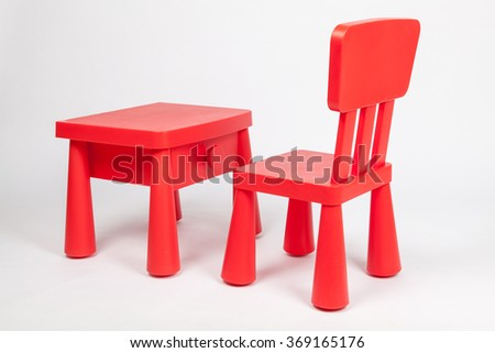 red chair and red table for children in kindergarten preschool classroom - stock photo