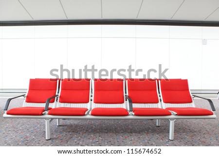 red chair at airport, shot in asia, hong kong, china - stock photo