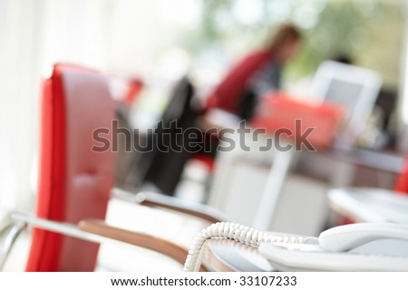 Red chair in the office. - stock photo