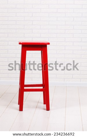 red chair on a brick wall background - stock photo