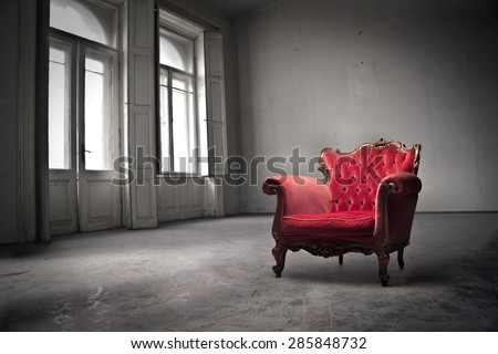 Red chair placed in a square - stock photo