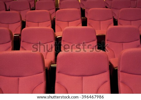Red chairs in the theater, close up