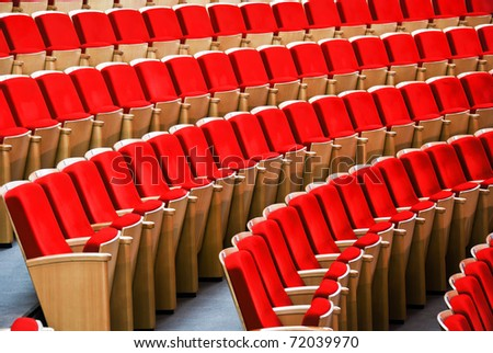 Red chairs of the auditorium - stock photo