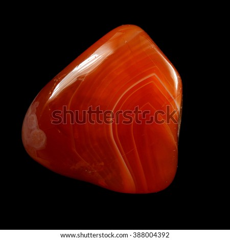 Red chalcedony (carnelian), isolated on black background