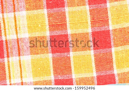 red checked fabric tablecloth - stock photo