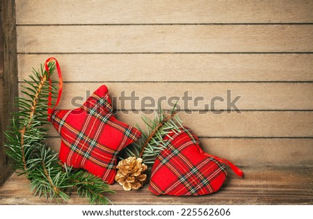 Red checkered star on wooden background - stock photo