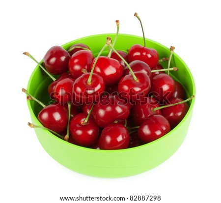 red cherries on a plate isolated on white