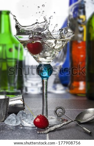 Red Cherry splashing into a Martini