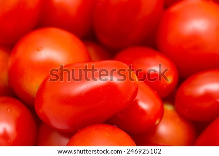 Red Cherry Tomatoes Group For Sale In Vegetable Market - stock photo