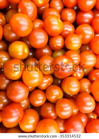 Red Cherry Tomatoes Group For Sale In Vegetable Market