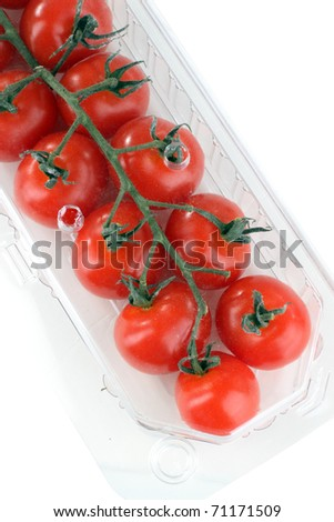 Red Cherry Tomatoes In A Plastic Retail Supermarket Packaging - stock photo