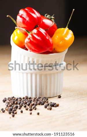 Red chili habanero peppers on old wooden table - stock photo