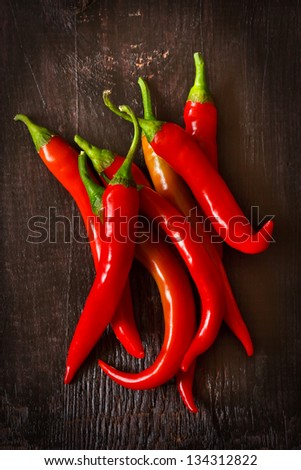 Red chili on an old wooden background. - stock photo