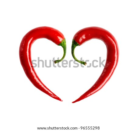 red chili pepper composed in the form of heart + clipping path - stock photo