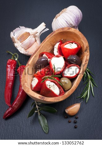 Red chili peppers filled with fresh cheese
