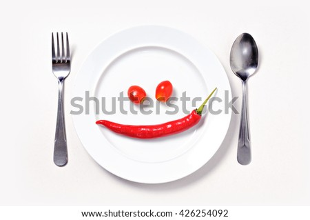 Red chili smile, close up white plate/ white background  - stock photo
